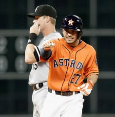 Jose Altuve, Houston Astros! Loooove this pic so much!! Yay for the little one!! :)