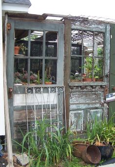 Old door greenhouse by Tara Dillard. Love this. Just attach old doors to a side of your home. taradillard.blogspot.com
