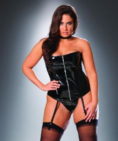 Zip up vinyl corset with boning and lace up back. Adjustable and detachable garters.