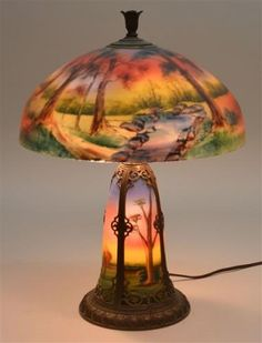 """Reverse Painted Lamp Attributed to Pittsburgh.arly 20th Century Reverse Painted Table Lamp Attributed to Pittsburgh. 18"""" shade with """"chipped ice"""" reverse painted decoration depicting an autumn landscape with trees and stream. Estimate: $1,200- $1,600"""