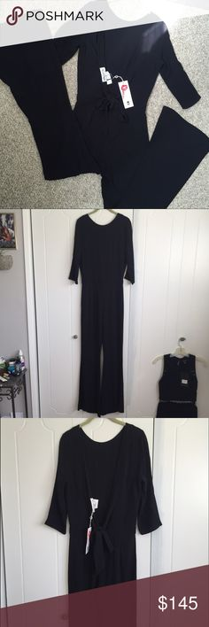 Nwt Wildfox Travel Jumpsuit Best for those 5'3 and taller. 60% rayon 40% viscose: rayon crinkle solid blend. Color: clean black. 3/4 sleeves featuring deep v back with attached tie and flare legs. Made in US. Cannot find model photos online :( Price firm, do not lowball please  Wildfox Tops