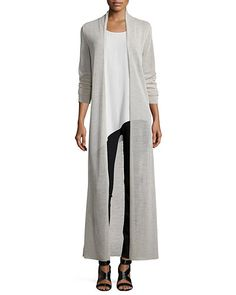 "Eileen Fisher crepe jersey cardiganin your choice of color. Approx. measurements: 53""L from shoulder to hem; 25 1/2""L sleeves. Open front. Long sleeves. Elegantly long silhouette. Hem hits mid-calf. W"