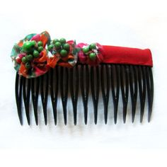 Lovely handmade fabric covered haircombs from Clari Design....follow us on FACEBOOK: https://www.facebook.com/ClariDesign