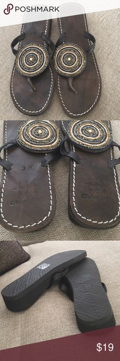 Leather beaded flip flip sandals All leather upper with beads. Rubber soles. Made in Kenya by global girls to raise funds for African children. Global Girls Shoes Sandals