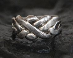 Puzzle ring. Yep, I remember mine. It was very similar to this.