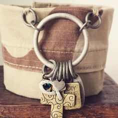 Tan, desert camouflage bracelet handcrafted from donated Navy uniform with metal, Christian, dangling charms. Benefits #military nonprofit #MedalsofHonor by #ValorBands on #Etsy