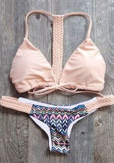Shed your inhibitions and have fun in the sun with this pink printed racerback bikini set.