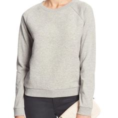 Banana Republic Gray Textured Raglan Sweatshirt Worn once.  Perfect condition.  Banana Republic Factory.  70% Cotton, 28% Polyester, 2% Spandex.  Machine wash.  Rounded neckline, ribbed trim, textured on the chest.  More info to come. Banana Republic Tops Sweatshirts & Hoodies