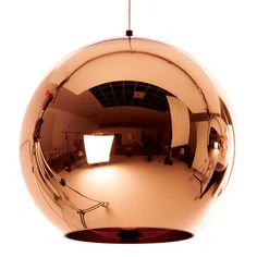Copper pendant light by Tom Dixon gives every room a subtle sophistication. A ultra thin layer of copper on a polycarbonate sphere creates a muted, beautiful glow. The lamp shade has a diameter of 25 cm and a he Round Pendant Light, Copper Pendant Lights, Globe Pendant Light, Copper Lighting, Contemporary Pendant Lights, Pendant Lighting, Pendant Lamp, Bronze Pendant, Copper Ceiling