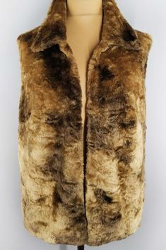 This bohemian faux fur vest will keep you warm and cozy! It will spice up your fall wardrobe and look gorgeous at festivals. Faux Fur Vests, Fall Wardrobe, Looking Gorgeous, Warm And Cozy, Festivals, Spice, Blazers, Fur Coat, Bohemian
