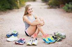 Teen girl shows off shoe collection during pictures - track or cross country senior portrait