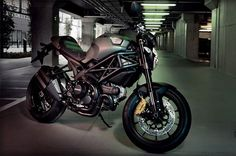 The Ducati Monster Diesel Motorcycle is a powerful street bike that is as notable for its military-inspired green and matte black color scheme as it is for its fantastic performance. It is based on Ducati's Monster 1100 EVO, and designed by Diesel's fashion stylists, led by company founder Renzo Rosso himself.