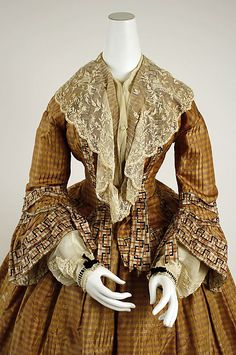 1850s extant gown, MET, delicate sheer pelerine and undersleeves with ribbons on the cuff.