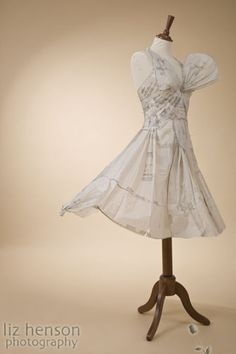 Studio Still Life Fashion Photography | Dress Making Pattern's made into a Paper Dress on a wooden mannequin