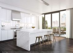 Modern White Marble Kitchen. Love the wrap around look (don't know design term) of carrera marble island. Want to use same stone on island as on countertops. Also like dark wood floor