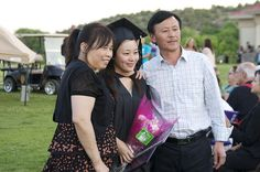 Stefanie Liu at graduation with her parents.  WNMU 2012