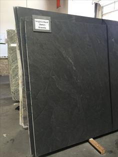 Virginia Black Granite in Satin or Honed finish.  Looks similar to soapstone.