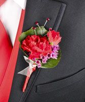 CRIMSON CARNATION Prom Boutonniere. Included in This Arrangement  Red Mini Carnation Blossom Red Mini Carnation Bud Green Galax Leaf Sprigs Lavender Waxflower Ft Red Satin Ribbon Ft Silver Sheer Ribbon Red Rhinestone Spray