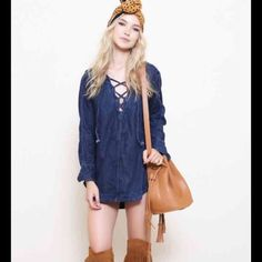 NWT Free People Size M DenimShirt Dress New with tags, retail $148.  Long sleeves with button closure.  Lace up front closure. Color is blue sky Free People Tops