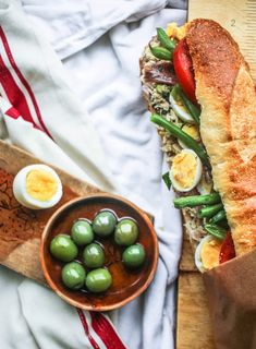 This sandwich, a classic of southern France, is perfect picnic fare. It's a Niçoise salad in a sandwich that wants — nay, needs — to be made in advance, so the bread soaks up the delicious flavors. Pan Bagnat, French Picnic, Nicoise Salad, Boiled Eggs, Hard Boiled, Best Sandwich, Fresh Rolls, Tuna, Entrees