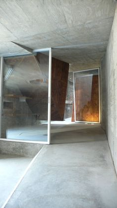 house s by suga atelier - interior covered by recycled plastic bottles' white polyester fiber mat and recycled plywood