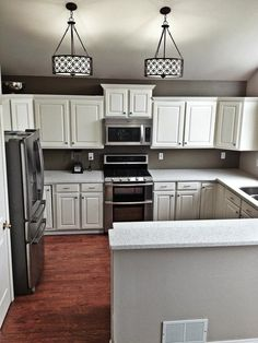 Kitchen after! Painted oak cabinets white, silestone counters, whirlpool gold star appliances, hand scraped hickory floors. Totally worth the work. Completed in 8 weeks for about $6k