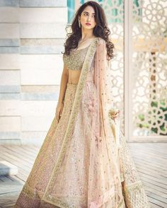 Indian wedding dresses are very beautiful. Usual indian bridal dresses made of chiffon or silk and adorned with elaborate embroidery, red or gold color. Indian Bridal Lehenga, Indian Bridal Outfits, Indian Bridal Wear, Bridal Dresses, Shaadi Lehenga, Net Lehenga, Indian Wedding Clothes, Heavy Lehenga, Gold Lehenga