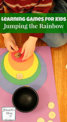 Learning Games for Kids- Jumping the Rainbow. This Jumping the Rainbow game works in fine motor skills, estimating and problems solving. Rainbow Party Games, Rainbow Activities, Kids Party Games, Montessori Activities, Spring Activities, Stem Activities, Activities For Kids, Crafts For Kids, Rainbow Learning