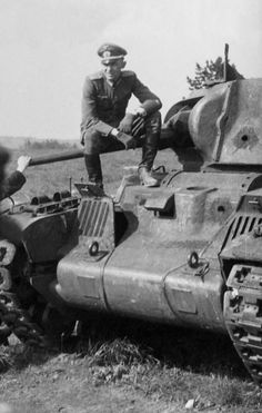 A Wehrmact officer from an anti-tank company sitting on top of a knocked out Land-Leased Matilda Mk.II tank used by Russians. The tank was KO after two rounds from a 75mm PAK 40 anti-tank gun punched through the upper frontal armor & turret (see the entry holes)?