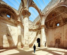 contemporary technologies are used to preserve and restore a deteriorating church without losing the feel of a historically rich ruin.