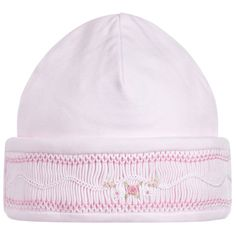 ebc7ca0f9c7 A cute grey-blue hat for baby boys and girls by Pasito a Pasito. The  outside is made in lightweight cotton