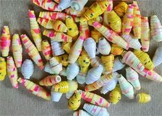 Nice multicolor mix of at least 70 yellow / white/ red / multicolor paper beads!   All these beads were hand-rolled by me from glossy photo paper type materials. (Many were also hand-colored!)   All were rolled using a 3/32 bead roller, and resulting beads fit easily, but not too loosely, over a standard size toothpick.   All my beads are made in my nonsmoking studio.   For these, I used Weldbond to glue, and Janice Maes Vibrance to give a water-resistant seal.   Thanks so much for your…