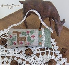 Designer : Gancedo Deer freebie Fabric: 28 ct. natural linen (stitched over one) Threads: WDW Stitched by Carol I.
