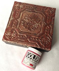 Make an antique-looking box out of thrift store finds and craft supplies