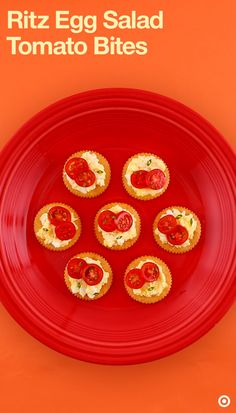 Easy, fun and delicious! This appetizer is a great side dish for any dinner or barbeque. All you need is Ritz Crackers, egg salad, grape tomatoes & chives. Start by placing crackers on a tray & top them with a layer of egg salad. Now cut grape tomatoes into thin slices & place them carefully on the crackers. For garnishing, place freshly chopped chives on each of them & it's done. Serve & enjoy!