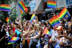 Spectators cheer during the New York City gay pride march June 26, 2011. The New York state legislature voted June 24 to become the sixth state in the US to legalize same-sex marriage.