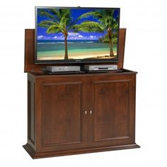 Hide your TV inside a cabinet using an electric  #TVLift ($1799.00). The Sanctuary TV Lift Cabinet in medium brown is the ultimate in TV, cable box, and DVD storage. All 4 sides of this cabinet are framed and finished allowing this cabinet can be used at the foot of your bed, against the wall, or free standing. Sanctuary conceals your television and two pieces of electronics (DVD and Cable Box). The TV and electronics travel up and down on the lift easily and quietly.