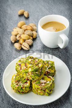 Picture of Turkish pistachio dessert with a some of pistachios and coffee. Toned image stock photo, images and stock photography. Turkish Recipes, Indian Food Recipes, Italian Recipes, Indian Desserts, Arabic Dessert, Arabic Food, Fish And Meat, Fish And Seafood, Pistachio Dessert