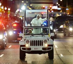 Pope Francis was heavily guarded as he was driven down Benjamin Franklin Parkway in a Jeep Wrangler popemobile