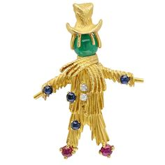 Van Cleef & Arpels Multi-Gem Diamond-Set Gold Scarecrow Brooch | From a unique collection of vintage brooches at https://www.1stdibs.com/jewelry/brooches/brooches/