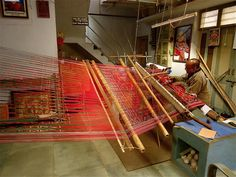 Patola is one of the most intricate forms of weaving in the world which involves dyeing both the warp and weft threads according to the final design before setting them on the loom for weaving. These weavers belong to the Salvi community and are believed to have come here from South India