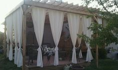Love this pergola with the curtains for privacy - so pretty! eclecticallyvintage.com