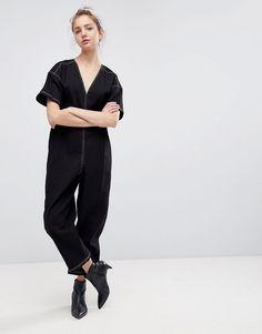 f7d0449ec56d ASOS Damen ASOS DESIGN – Minimalistischer Jumpsuit mit tiefem Ausschnitt  und weitem Bein –   2201480686304