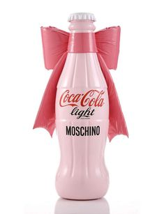 "As the part of its ""Tribute to Fashion"" charity project, Coca Cola asked some of the best Italian designers to put their stamp on its limited edition bottle, including Moschino, Donatella Versace, Angela Missoni, Alberto Ferreti, Consuelo Castiglioni and Etro, who showcased their creations at the Milano Fashion Centre."