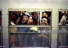 View of passengers in a subway car, New York, New York, 1988.