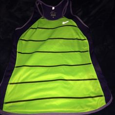 Nike Dri-Fit Tank  Lime green and dark purple Dri-Fit tank! Great condition minus two small pulls (pictured below) ... Not noticeable when on. Only worn once. Nike Tops Tank Tops