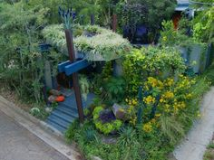 """WIth the help of a landscape architect, Felder enclosed his front garden and built a """"green roof"""" entry arbor. The garden was also reversed - it now faces the house rather than the street."""