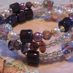 PURPLE PASSIONS $20   pinks  purples pearls crystals  glass   beautiful sexy  classy     memory wire bracelet