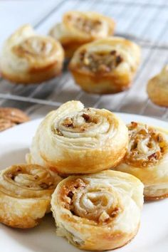 Pecan Pie Cinnamon Rolls are incredibly easy. Frozen puff pastry, some sugar, pecans, and butter, and you've got one magnificent brunch treat!