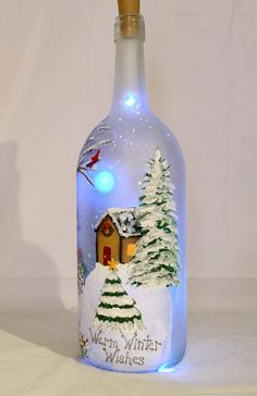Christmas Lighted Bottle, Snowman Painted Wine Bottle Christmas illuminated bottle of snowman painted wine bottle Wine Bottle Images, Wine Bottle Art, Painted Wine Bottles, Lighted Wine Bottles, Bottle Lights, Bottle Bottle, Wine Bottle Centerpieces, Christmas Wine Bottles, Glass Bottle Crafts